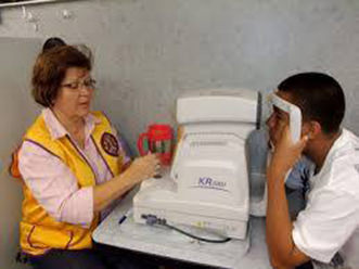 Image of an adult receiving a computerized eye screening