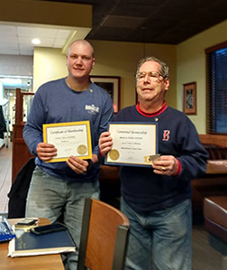 The photo at the center is of both new Lion Jim Beyer and President Marty holding their Certificates of Membership and Certificates of Sponsorship respectively.